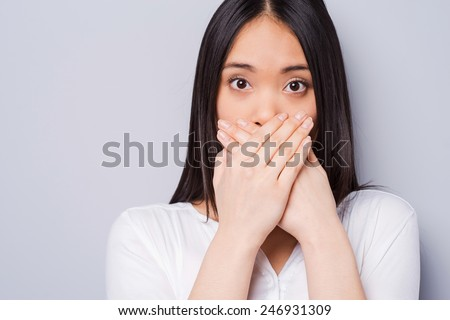 Image of surprised woman 20s with long hair covering mouth with  Stock photo © deandrobot