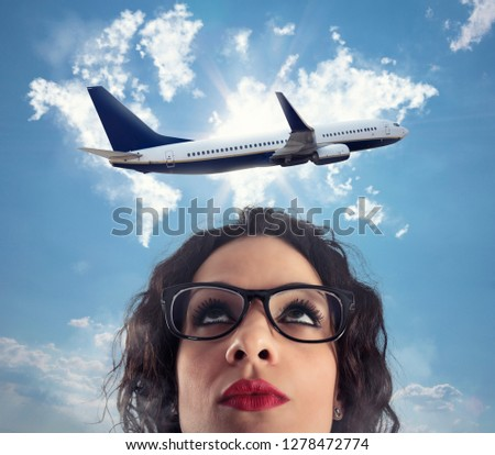 Woman wants to take a break from her work for a airplane trip Stock photo © alphaspirit