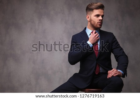 portrait of curious businessman in navy suit touching his chest Stock photo © feedough