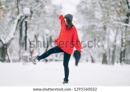 счастливая · девушка · весело · вверх · снега · ногу · красный - Сток-фото © Stasia04