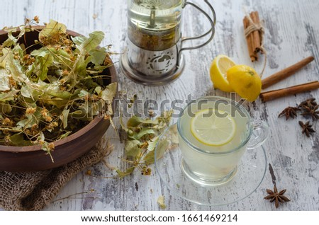 linden flowers with leaves in wooden bowl on wooden table tilia stock photo © virgin