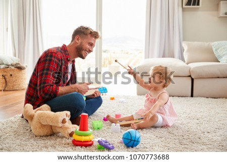 father playing with baby daughter on sofa at home Stock photo © Lopolo