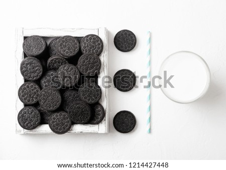 Sandwich black cookie consisting of two chocolate wafers with cream filling with glass of milk on st stock photo © DenisMArt