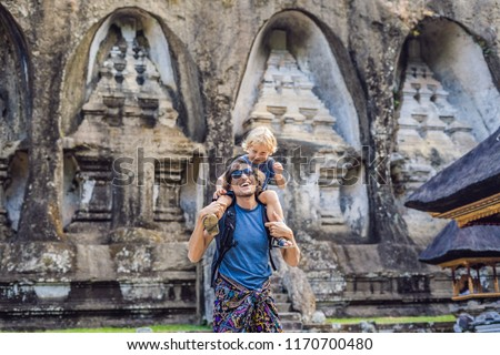 Dad and son on background of Gunung Kawi. Ancient carved in the stone temple with royal tombs. Bali, Stock photo © galitskaya