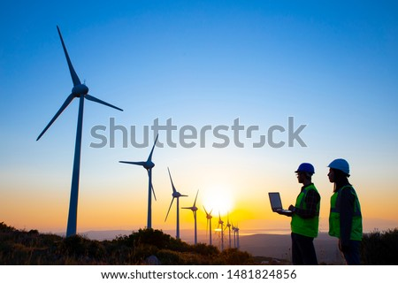 A Technician team Engineer in Wind Turbine Power Generator Station Stock photo © Lopolo