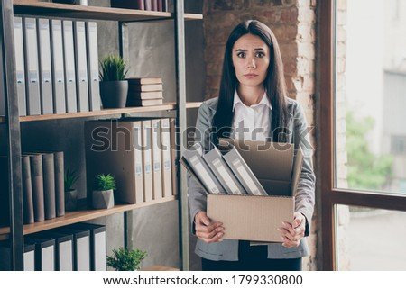 Photo of shocked businesswoman wearing office suit holding silve Stock photo © deandrobot