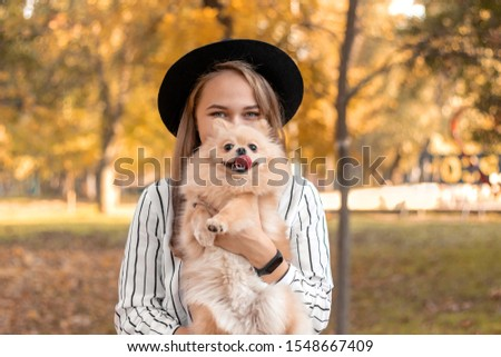 A young girl of the European appearance holds a dog breed Chihuahua, plays with her, kisses her, sum Stock photo © ElenaBatkova