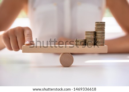 Businessperson Balancing Increasing Stacked Coins With Finger Stock photo © AndreyPopov