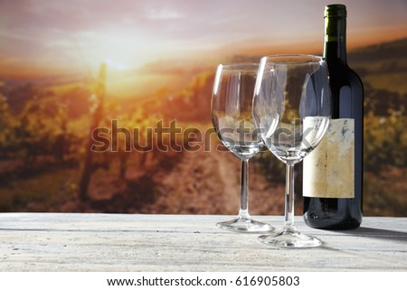 Bottle of red wine on wood with empty glasses with dark grapes with corks and opener inside vintage  Stock photo © DenisMArt
