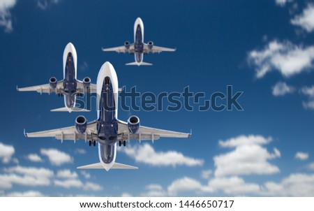 bottom view of several passenger airplanes flying in the blue sk stock photo © feverpitch