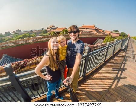 Enjoying vacation in China. Happy family with national chinese flag in Forbidden City. Travel to Chi Stock photo © galitskaya