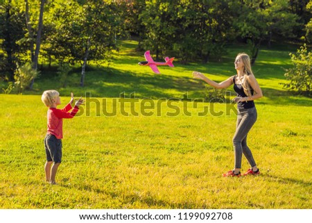 Mother and son playing with a large model toy aeroplane in the p stock photo © galitskaya