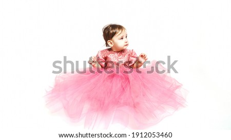 happy little baby girl in bright pink dress isolated on a white background Stock photo © Lopolo