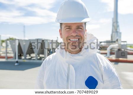 Professionele uniform masker handschoenen dak schoonmaken Stockfoto © Lopolo
