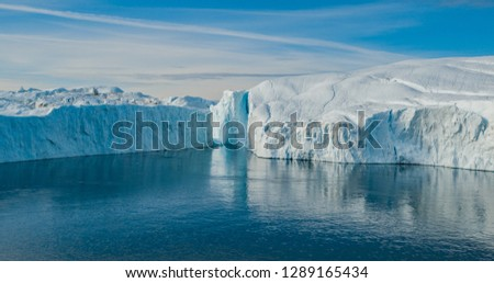 iceberg aerial photo   giant icebergs in disko bay on greenland stock photo © maridav