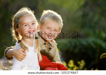 Portrait of adorable brother and sister smile and laugh together Stock photo © dashapetrenko