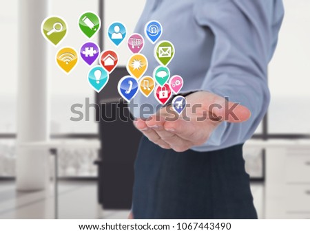 Businesswoman with hand spread of  and application icons coming up from it. Grey background Stock photo © wavebreak_media