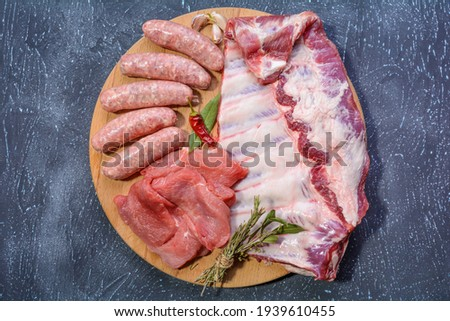 Stock photo: Steak pork grill on wooden cutting board with a variety of grilled vegetables