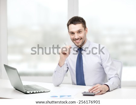 Male accountant calculations and analyzing financial graph data  Stock photo © Freedomz