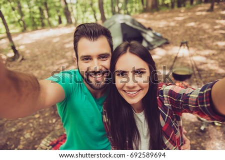 happy couple camping on the nature, taking a selfie shot of smil stock photo © Freedomz