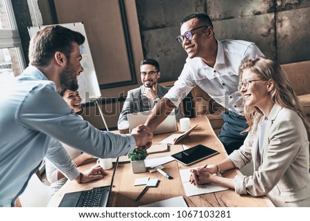 Meeting and greeting, Business team colleagues discussing workin stock photo © Freedomz