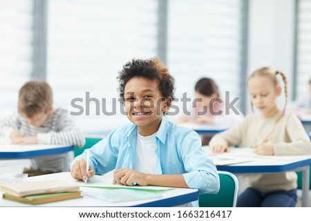счастливым школьник глядя камеры классе Сток-фото © wavebreak_media