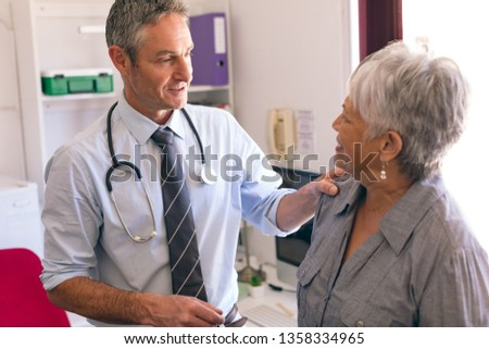 Front view of female doctor interacting with senior people while playing card and taking coffee arou Stock photo © wavebreak_media