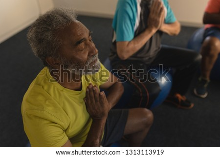 High angle view of active senior men performing yoga doing exercice ball at home Stock photo © wavebreak_media