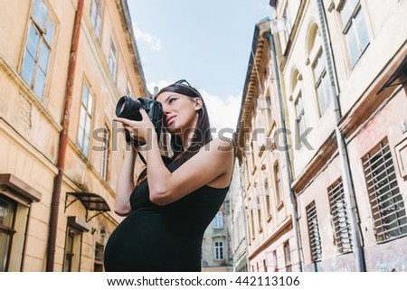 Pretty, young woman taking photos with her professional camera Stock photo © lightpoet
