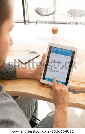 Contemporary client of mobile bank looking through online financial information Stock photo © pressmaster