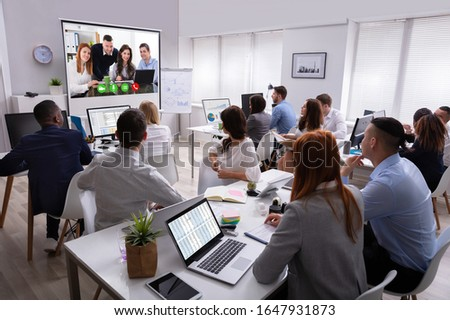 rear view of multi ethnic business team attending video call with african american oversees colleagu stock photo © wavebreak_media
