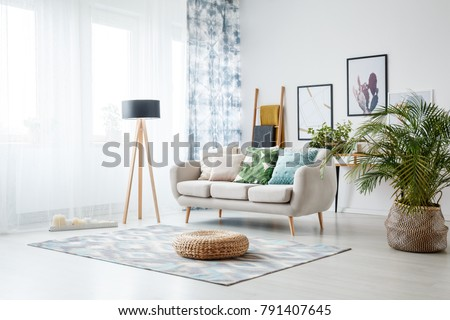 Basket and candles in front of a window shedding light on the in Stock photo © dashapetrenko