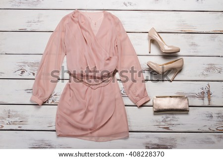 Women's outfit on wooden background. fashion clothes. beige straw hat, beige pant, white shirt, gree Stock photo © Illia
