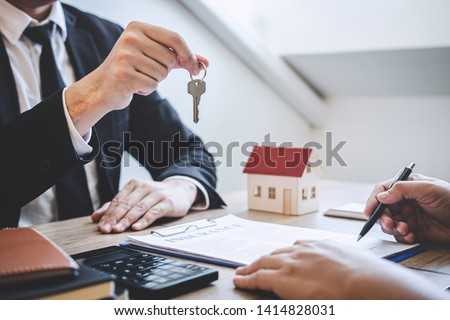 agent giving house keys to customer after sign agreement propert stock photo © snowing