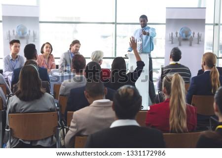 Achteraanzicht halfbloed zakenvrouw hand business seminar Stockfoto © wavebreak_media