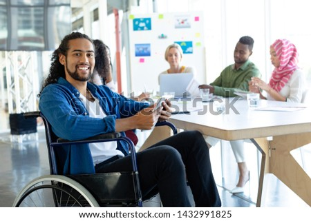 Front view of happy disabled young mixed-race female executive with handsome young Caucasianbusiness Stock photo © wavebreak_media