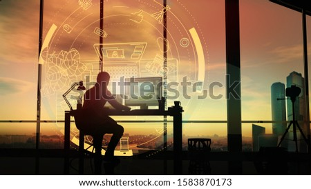 At sunset, a photographer in his office in front of a holographic projection. Stock photo © ConceptCafe