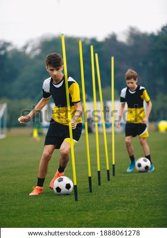 Coach teaching kids on soccer training unit. Young boys sitting together with coach on grass pitch.  Stock photo © matimix