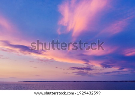 Bright cloudy sky purple violet pink colors sunset over Torrevie Stock photo © amok