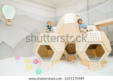 Two intercultural restful cute kids in casualwear spending time on playground Stock photo © pressmaster