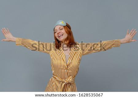 Pozitív nyugodt nő csíkos köntös karok Stock fotó © vkstudio