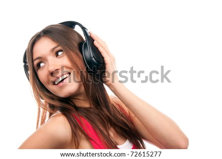 Horizontal shot of young Caucasian woman enjoys music from playlist, listens favourite song with ear Stock photo © vkstudio