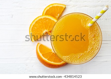 Top view of fresh oranges and fresh orange juice in glass, wooden juicer on white table. Multifruit  Stock photo © vkstudio