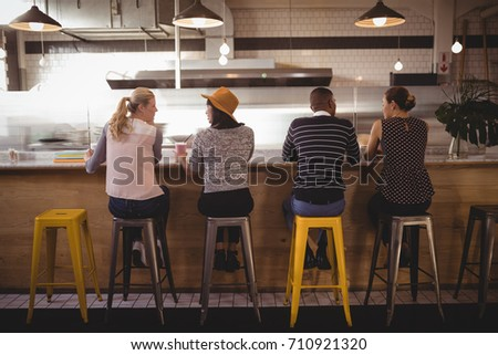 Rear view of a group of multi-ethnic friends interacting with each others in camper van at beach on  Stock photo © wavebreak_media
