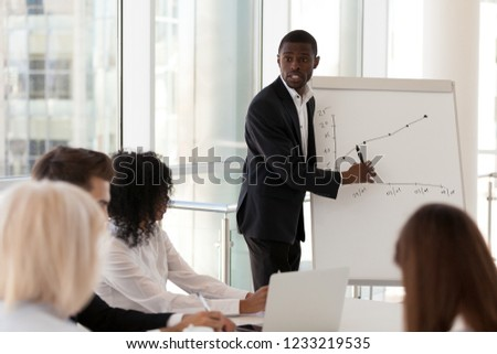 Businesspeople in startup company looking at graphs and figures Stock photo © Kzenon