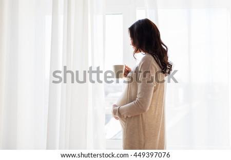 Közelkép terhes nő csésze tea otthon terhesség Stock fotó © dolgachov