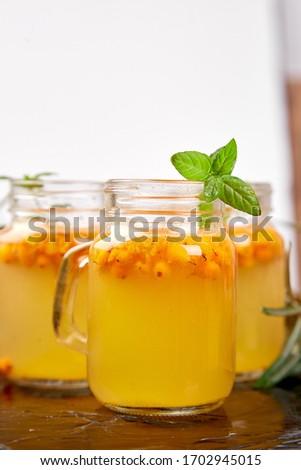 Vitaminic healthy sea buckthorn tea, Virus protection drink, coronavirus, immunity concept. Stock photo © Illia