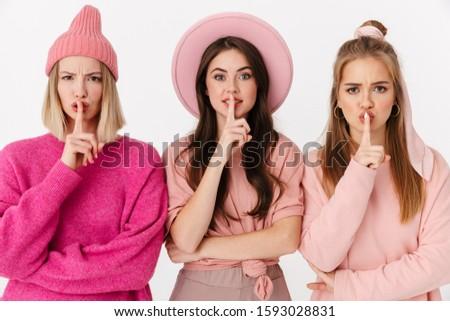 Immagine tre ragazze dita labbra Foto d'archivio © deandrobot