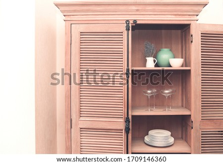 Retro styled cupboard with disheslike plates, tableclothes, vase Stock photo © dashapetrenko