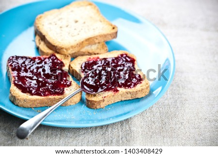 Toasted cereal bread slices on blue ceramic plate and homemade w Stock photo © marylooo